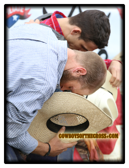Bull Rider Dixon Holland from Virginia pauses to pray during the opening of a recent bull riding in Wise, VA sanctioned by SEBRA (Southern Extreme Bull Riding Association) .